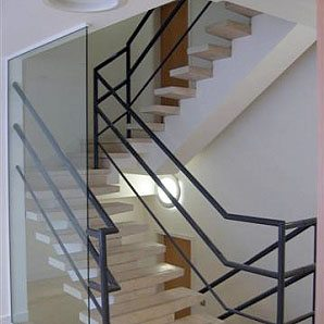 White Painted Walls and Glass Staircase